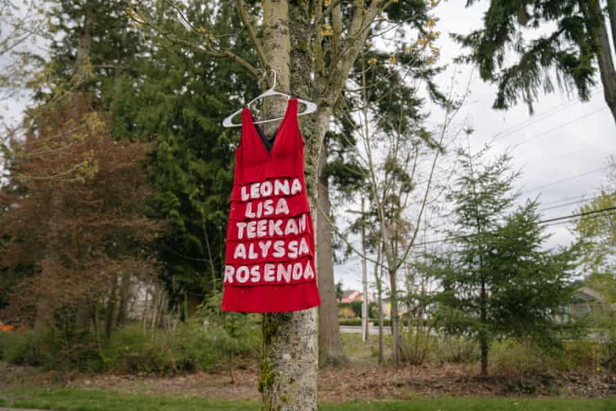 A red dress, symbolizing missing and murdered indigenous women, hangs on a tree at Morrill Meadows Park in Kent, Washington.