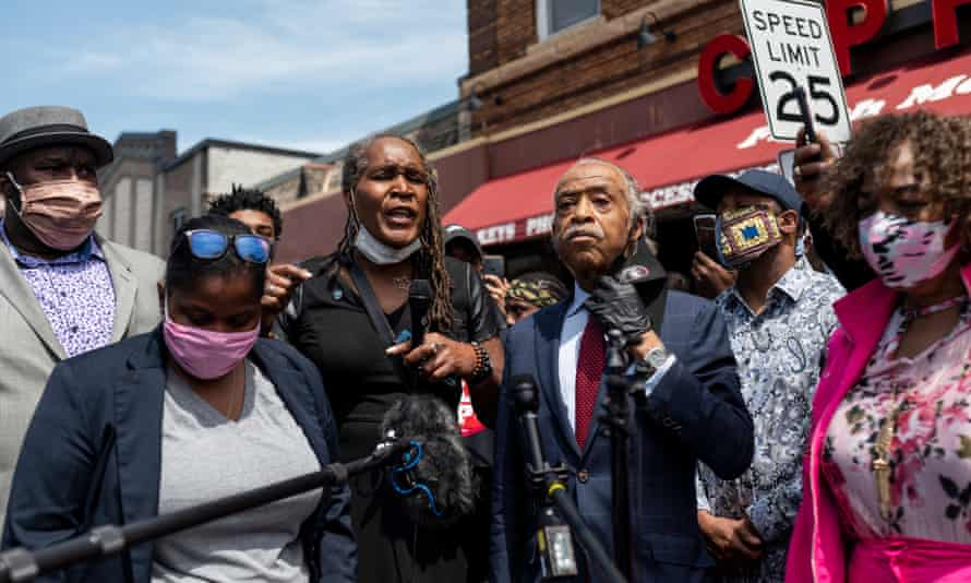 Andrea Jenkins at a vigil for George Floyd with Rev Al Sharpton, centre, and activist Gwen Carr, right, whose son, Eric Garner, who was killed by New York police in 2014.