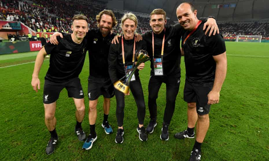 Andreas Kornmayer, head of fitness and conditioning, Mona Nemmer, head of nutrition, Christopher Rohrbeck, first-team physiotherapist, Conall Murtagh and Tom King, first-team fitness coach, with the FIFA Club World Cup in Doha.