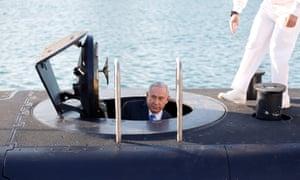 Israeli PM Benjamin Netanyahu climbs out of the submarine Rahav in Haifa.
