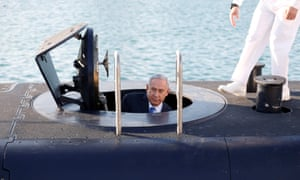 Benjamin Netanyahu climbs out after a visit inside the Rahav, the fifth submarine in the fleet, after it arrived in the port of Haifa