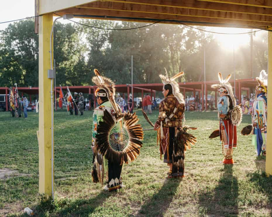 People participate in the All Veteran's Wacipi, a pow-wow on the Pine Ridge Reservation meant to commemorate Lakota who served in the US military. Indigenous Americans serve in the military at a higher rate than any other group.