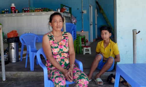 Nguyen Thi Ngoc Tham and her son, Phuc Thinh, at Long Hai beach