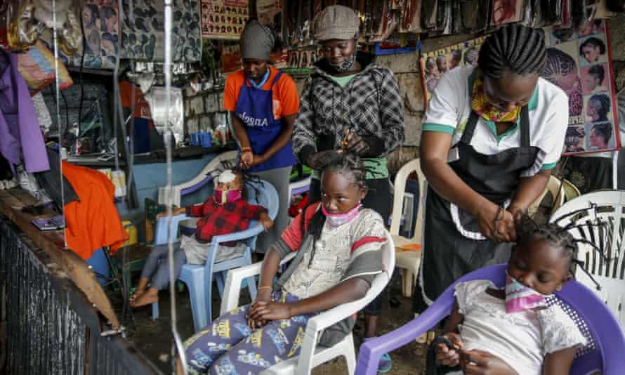 Children have their hair braided at the Mama Brayo beauty salon in Kibera, Nairobi.