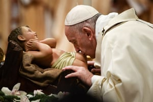 Vatican City: Pope Francis kisses a figure of the baby Jesus as he arrives to celebrate the Epiphany mass at St Peter's Basilica