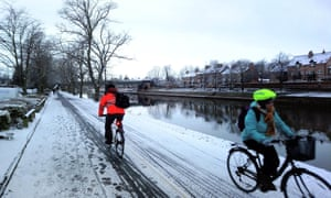 Cyclists in icy conditions on one of York's riverside paths – now the city will clear cycle tracks and walkways first.