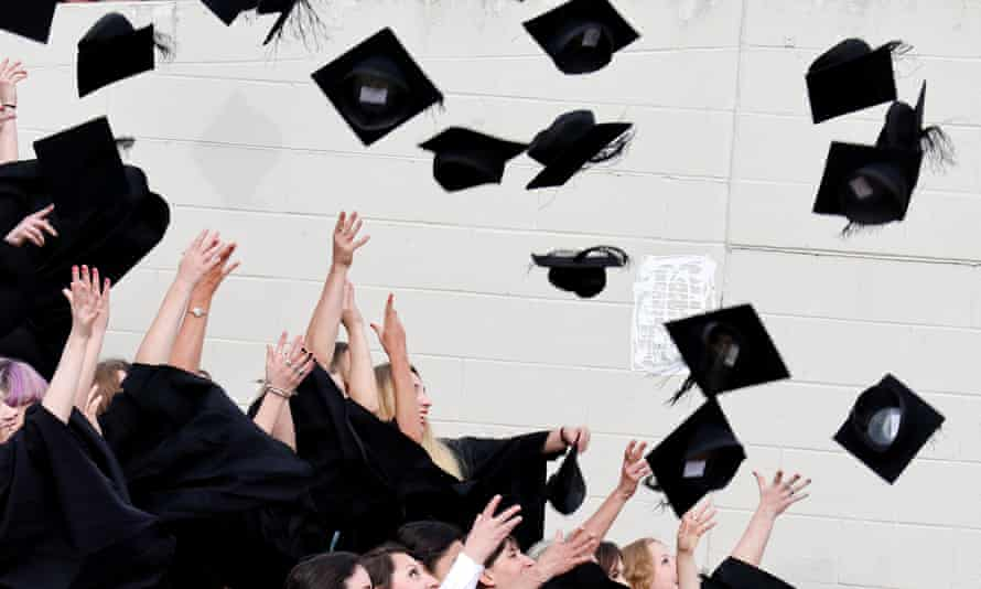 Warwick University graduates throw their mortar boards into the air
