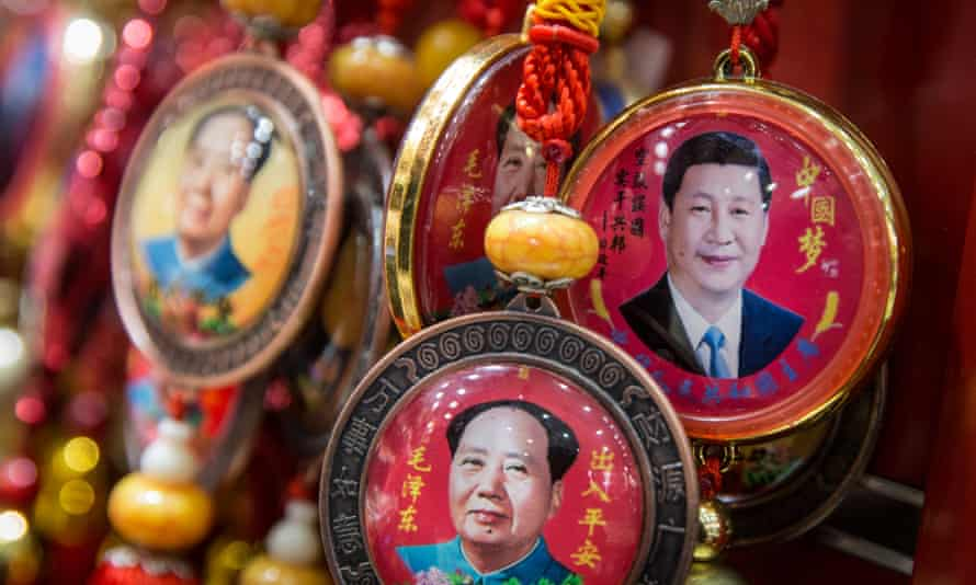 Souvenirs with portraits of Chinese president Xi Jinping and former Chinese leader Mao Zedong in Beijing, China