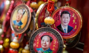 Souvenirs with portraits of Chinese President Xi Jinping and former Chinese leader Mao Zedong are displayed at a shop in Beijing, China.