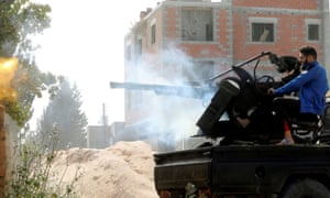 A member of the Tripoli government forces fires during a fight with eastern troops.