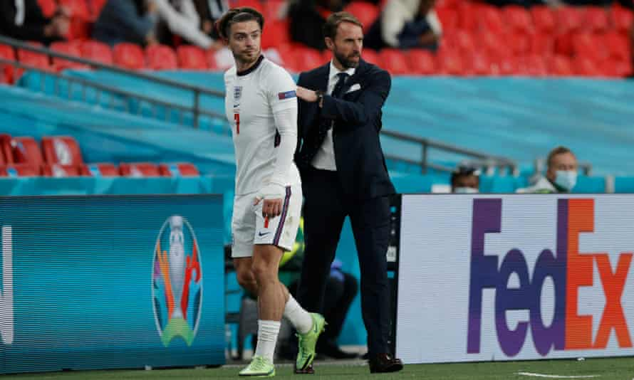 Jack Grealish with Gareth Southgate, who had concerns about the player's defensive work and used him sparingly at Euro 2020.