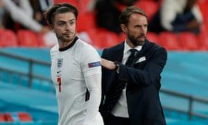 England Manager Gareth Southgate congratulates Jack Grealish on his performance.