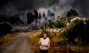 A villager shouts for help as a wildfire approaches a house at Casas da Ribeira village in Mação, central Portugal on July 2019.