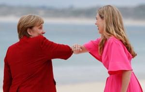 German chancellor Angela Merkel greets Carrie Johnson