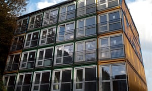 Shipping containers that have been converted to residential use for homeless people in Brighton.