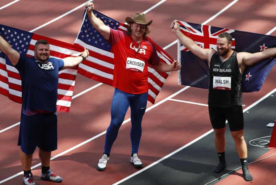 Gold medal winner Ryan Crouser (centre) with silver medallist Joe Kovacs (left) and bronze medallist Tomas Walsh.