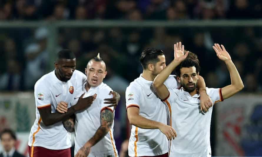 Roma's Mohamed Salah celebrates with his team-mates after scoring against his former club Fiorentina.