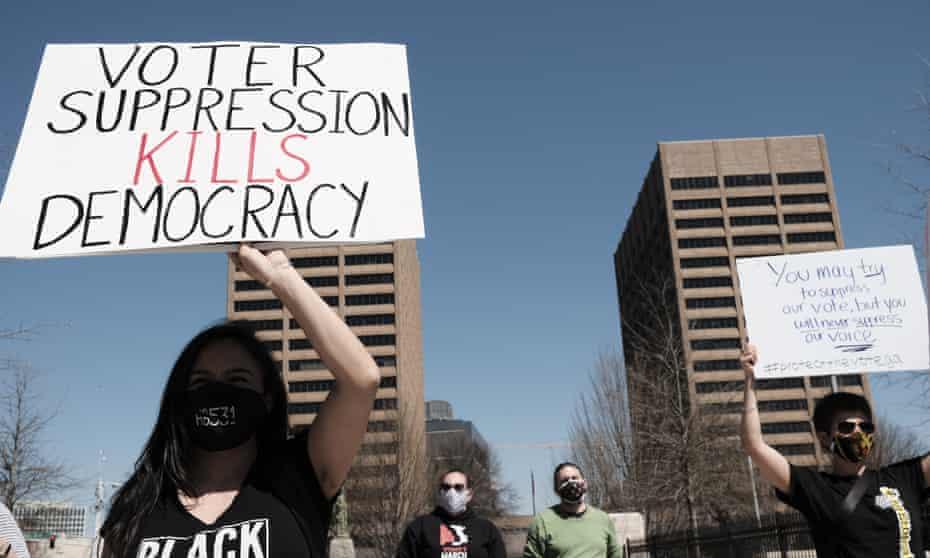 Demonstrators rally in Atlanta, Georgia, on 8 March.