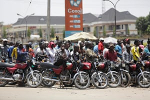 Motorcycles wait for fuel at the petrol station in the Nigerian capital Abuja