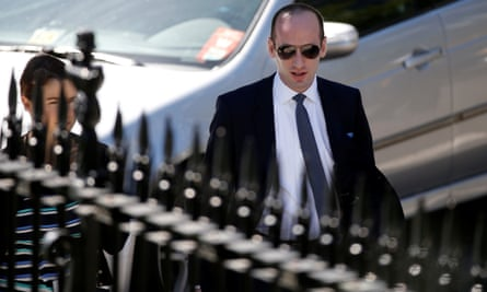 Policy adviser Stephen Miller walks on the White House grounds.