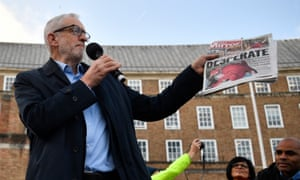Jeremy Corbyn holds up a copy of the Daily Mirror showing a photograph of Jack Williment-Barr at a rally in Bristol, December 2019