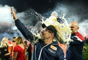 Union Berlin coach Urs Fischer gets a beer shower.
