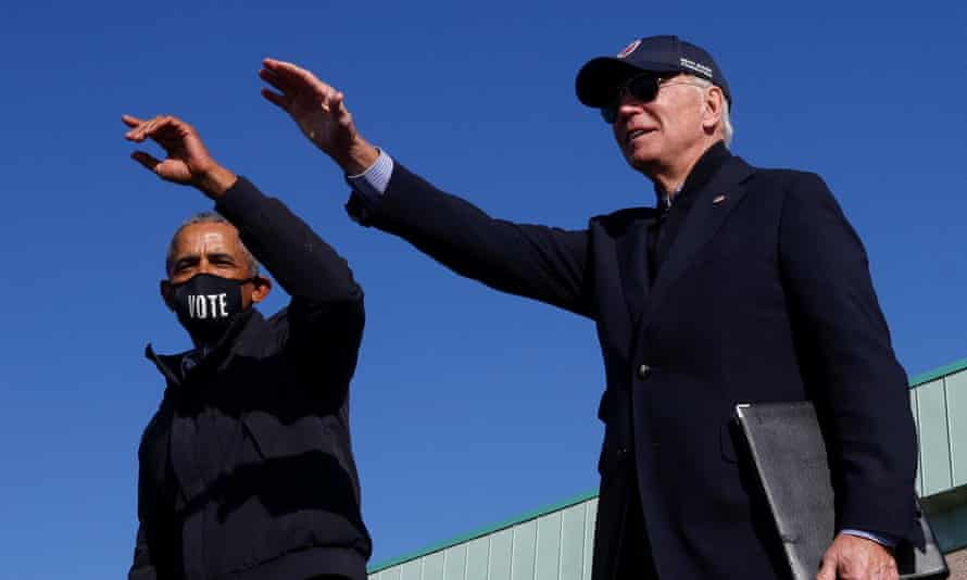 Joe Biden and former president Barack Obama at a campaign drive-in, mobilisation event in Flint, Michigan on Saturday.