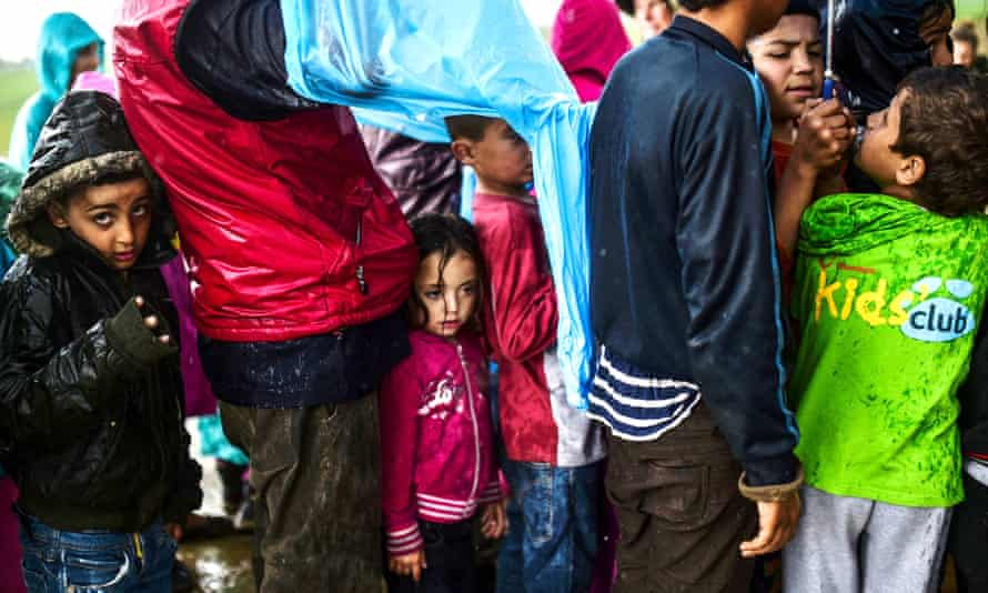 Child refugees queuing for food at the makeshift camp at Idomeni, northern Greece.