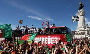 Marquis of Pombal Square in Lisbon is packed with Portugal fans waving flags and scarves as well as brandishing mobile phones to film their returning heroes.