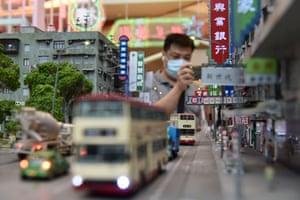 Hong Kong, ChinaVisitors look at models during 'Love at Kwun Tong Miniature' exhibition showcasing the old Kwun Tong at YM2 shopping mall