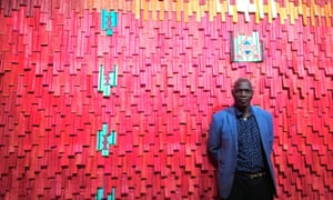 A cry for peace … Malian artist Abdoulaye Konaté with his work Touareg Rouge No 1.