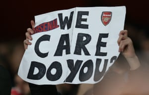 An Arsenal fan holds a poster up at Unai Emery's final game.