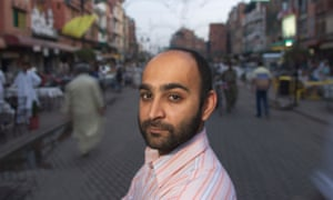 Author Mohsin Hamid on Anarkali Street in Lahore, Pakistan.
