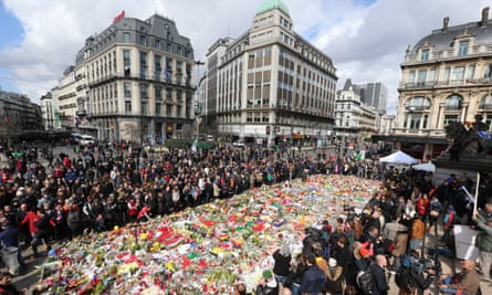 Crowds gather in Brussels' Place de la Bourse in March to pay tribute to victims of its terrorist attacks.