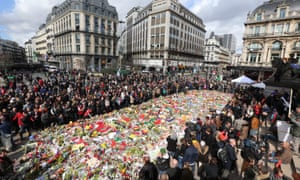 Belgians pay tribute to the victims of Brussels terror attacks, in Brussels, in March.