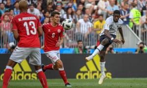 France's Ousmane Dembélé tries a shot at the Denmark goal