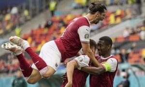 Austria's Christoph Baumgartner (centre) celebrates with Florian Grillitsch (left) and David Alaba after scoring the opening goal.
