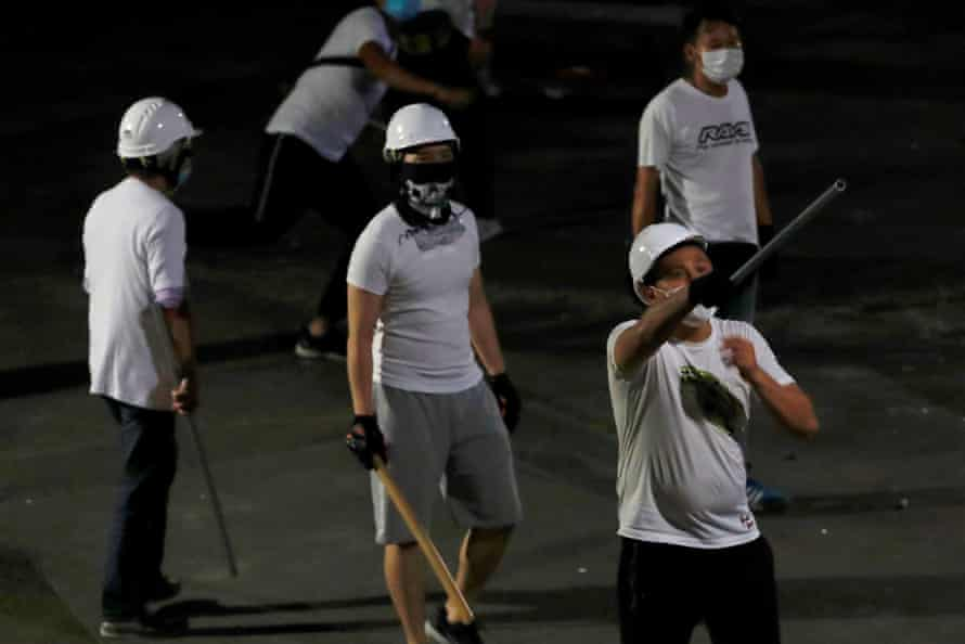 Thugs in white shirts in Yuen Long after pro-democracy demonstrators were attacked at a train station