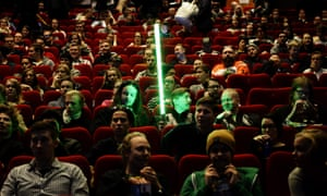 """A Star Wars fan waits with his mock light sabre for the start of the movie premiere of """"Star Wars: The Force Awakens"""" in Helsinki, Finland on December 16, 2015. After months of teasing trailers that raised more questions than answers, and a Hollywood premiere Monday from which the celebrity audience emerged smiling but sworn to secrecy, some of the franchise's millions of fans finally got to see it for themselves. / AFP / LEHTIKUVA / Vesa Moilanen / Finland OUTVESA MOILANEN/AFP/Getty Images"""