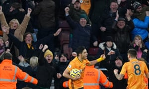 Raul Jimenez of Wolves turns to celebrate after scoring the penalty.