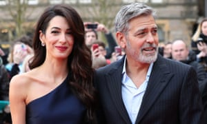 George and Amal Clooney, representing the Clooney Foundation for Justice, arriving at a charity gala at the McEwan Hall in Edinburgh.