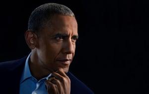 Head shot of former US president Barack Obama against black background