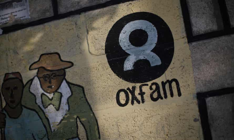 An Oxfam sign is seen on a wall in Corail, a camp for displaced people of the earthquake of 2010, on the outskirts of Port-au-Prince, Haiti, February 17, 2018. REUTERS/Andres Martinez Casares - RC11F1401960