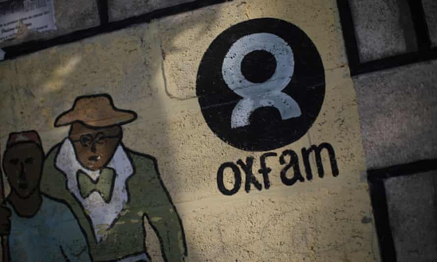An Oxfam sign is seen on a wall in Corail, a camp established on the outskirts of Port-au-Prince for people displaced by the earthquake that hit Haiti in 2010