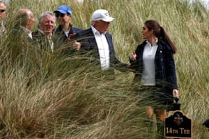Donald Trump speaks to Hope Hicks on the golf course at his Trump International Golf Links in Aberdeen, Scotland, on 25 June 2016.