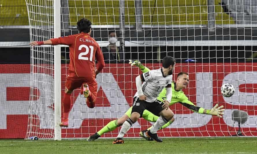 Eljif Elmas (left) scores the decisive second goal for North Macedonia against Germany.