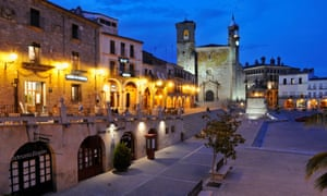 View of Plaza Mayor city square and San Martin church at dusk, Trujillo, Spain.