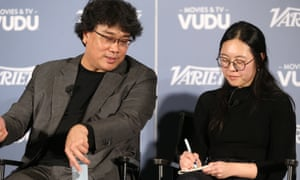 Bong Joon Ho and Sharon Choi at a Parasite press conference in December.