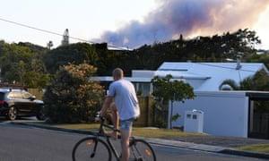 Dark smoke billows from a bushfire near Peregian Beach on the Sunshine Coast on Tuesday.