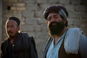 Jan Khan, right, a shop keeper from Uruzgan, fled the fighting with his family and they now live in the unfinished property in Kandahar.